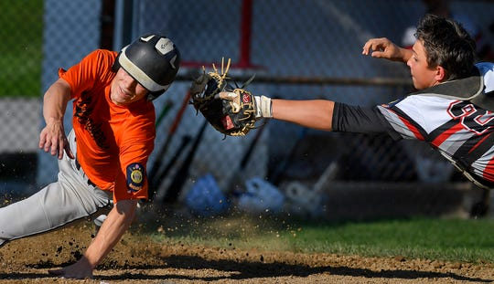 Southwest catcher Sam Lau makes a diving attempt to tag Wade Wolfganf of Northeastern, Monday, July 8, 2019.John A. Pavoncello photo