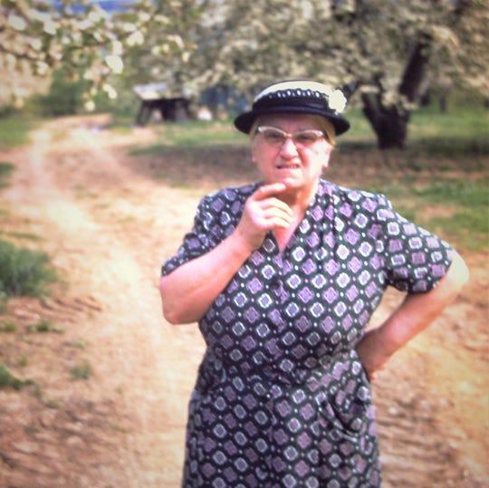 Grammy Lottie, taken around 1959/60 in a cherry orchard on Fahs' Fruit Farm.