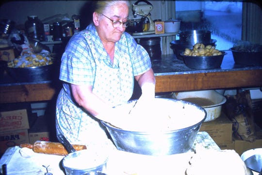Grammy Lottie mixing up pie dough in the bakehouse. Circa about 1959.