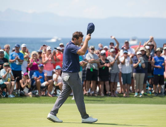 Tony Romo tips his hat to the crowd after winning the American Century Championship at Edgewood Tahoe Golf Course last year.