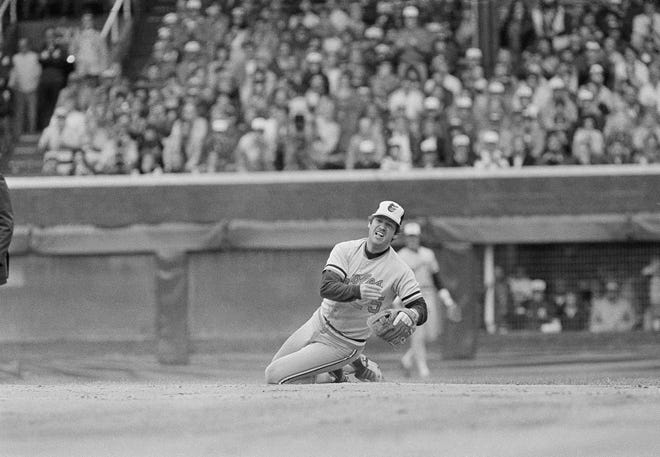 Rich Dauer of the Baltimore Orioles throws to first after making a diving catch in the first inning of the American League playoff game against the Chicago White Sox on Saturday, Oct. 8, 1983, inChicago. Sox runner Carlton Fisk was able to beat the throw at first.
