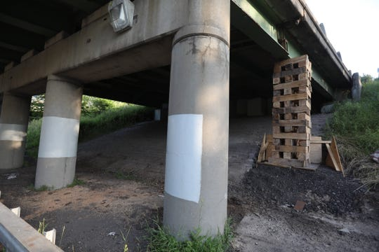 A Jenga-like structure is lending support, temporarily, to an Interstate 590 overpass near Blossom Road.