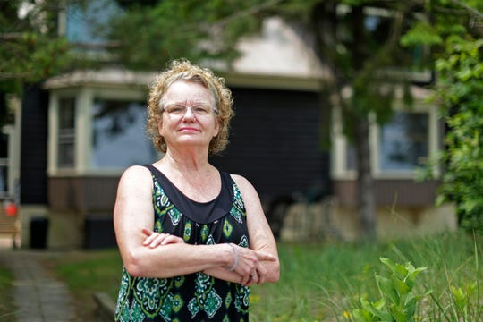 Louise Robson of Sheboygan Falls, Wis., poses outside her town of Holland cottage, Monday, July 8, 2019.