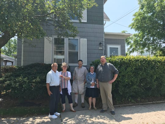 Tom Schroedel stands in front of the Manor with board members Barb Gutenberger (holding the keys to the  Clara Avenue residence), Bob Danforth, Elizabeth Stroot and executive director Erik Buchelt. Schroedel was the director of the residence, formerly Our Place.