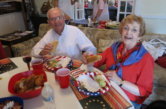 Dr. Seborn E. and Loralee Woods chow down on All-American food at Guths July 2 Lunch at Fairview Farm