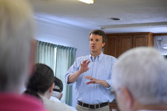 6th District Rep. Ben Cline answers a question from a town hall attendee on Tuesday. The town hall was held in Stuarts Draft at the Veterans of Foreign War post.