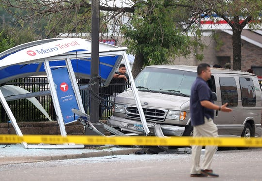 At least six people were hurt, including three critically, when a van slammed into a crowded bus stop shelter in north Minneapolis. All six were transported to hospitals. Metro Transit spokesman Howie Padilla says police took the driver of the van into custody following the crash about 9:30 a.m. Tuesday, July 9, 2019. (David Joles/Star Tribune via AP)