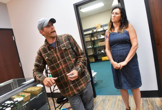 Justin and Julia Trott talk about the many types of cannabis items available Tuesday, July 9, 2019, at 419 Hemp in St. Cloud.
