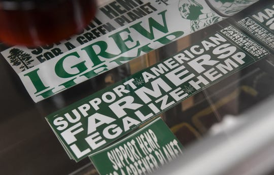 Bumper stickers in support of industrial hemp are pictured at 419 Hemp in St. Cloud, Minn.