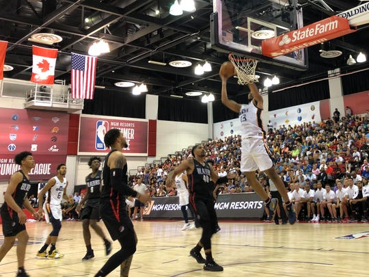 The Jazz's Tony Bradley rises for an alley-oop against the Trailblazers on Tuesday.