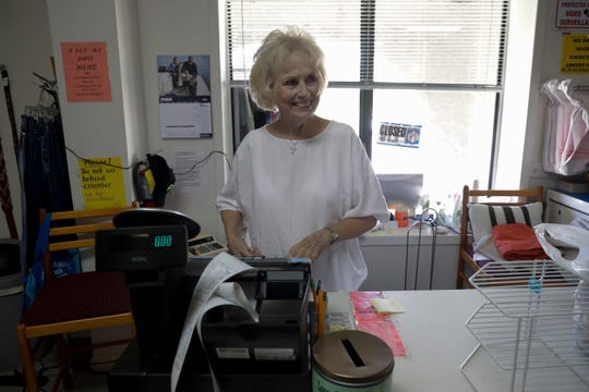 Judy Bailey, an employee at Calhoun Liberty Center Thrift Store, bags up items for a customer Tuesday, July 2, 2019. Her husband is a regular patient at Liberty Calhoun Hospital and she has been a patient there multiple times.