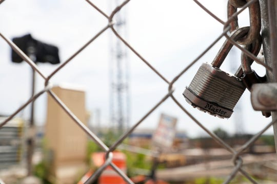 A Master lock keeps the fences of Washington Square closed as it seems construction has come to an abrupt halt Tuesday, July 9, 2019.