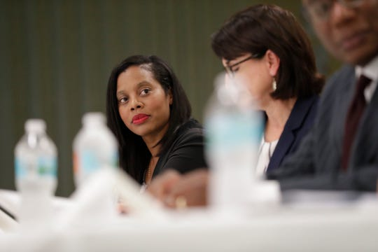 Jami Coleman, attorney for Annabelle Dias, listens as a 10-member task force created to remove racist language from property covenants in some Tallahassee neighborhoods met at Bethel Family Life Center Tuesday, July 9, 2019.