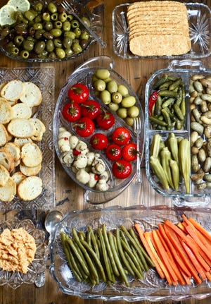 Put together a relish tray with a Southern spin including pickled okra and boiled peanuts.