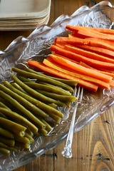 Don't have cut glass dishes for your marinated green beans and carrots? Get creative with martini glasses, muffin tins or saucers for your relish goodies.