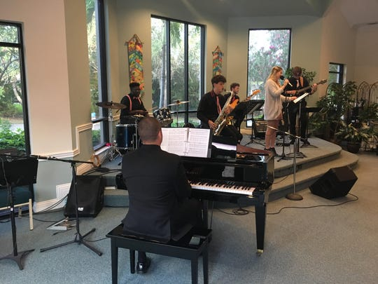 Music director and pianist Jacob Craig performs with student musicians Warren Williams, left, Dominic DeGrandis, Robert Kerstein, Kristi Beckett and Ryan Dillahay on  June 29 at the Unity Spiritual Center of Vero Beach.