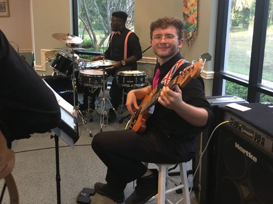 "Indian River Charter High School student Robert Kerstein plays bass during the ""Have Piano will Duel"" performance June 29 at the Unity Spiritual Center of Vero Beach. Warren Williams is on drums."