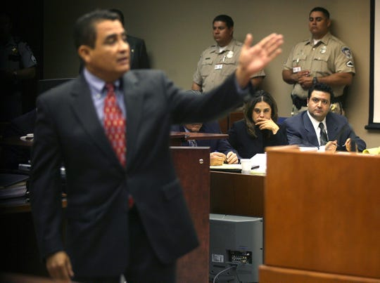 Convicted killer David Renteria, seated right, and one of his attorneys listen to District Attorney Jaime Esparza in this April 22, 2008, photo during a resentencing hearing for Renteria in 41st District Court.