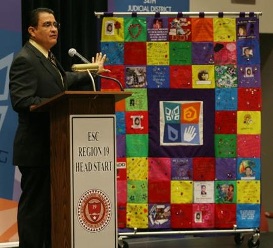 2009: District Attorney Jaime Esparza showed a quilt made up of panels fashioned by crime victims' families.