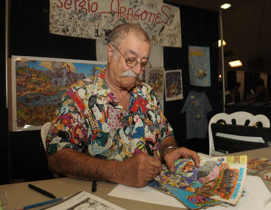 "ROB VARELA/THE STAR  Artist Sergio Aragones, an Ojai resident, signs copies of his comic book, ""Groo the Wanderer"" in this file photo."
