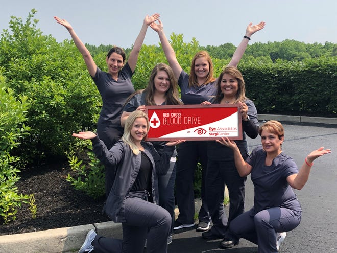 "Staff members from Eye Associates and the SurgiCenter of Vineland ""advertise"" for donors for the center's recent American Red Cross Blood Drive"