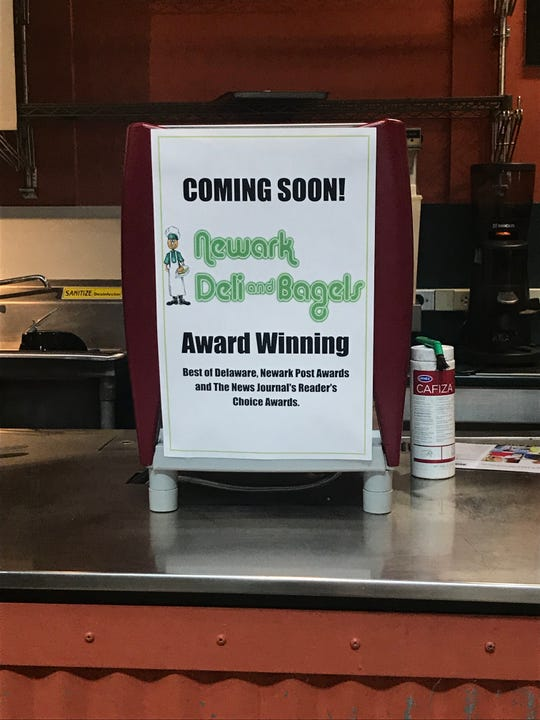 A sign touting the new Newark Deli and Bagels kiosk coming to Wilmington's Riverfront Market.