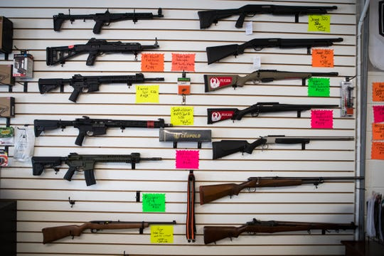Firearms for sale at Firing Distance gun store in Bridgeville, Del. The guns in question under recently proposed assault weapons bans have been focused around semiautomatic guns and not traditional hunting guns.