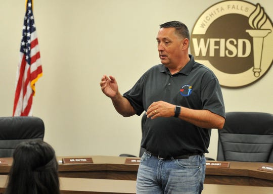 Wichita Falls ISD Superintendent Michael Kuhrt speaks to a small crowd of students and parents shortly before a scholarship presentation at the Education Center as shown in this July 1, 2019, file photo.