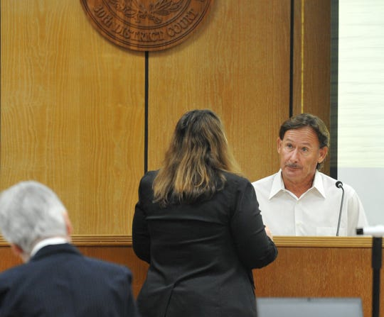 Gordon Mickan, right, answers questions July 9 in the 30th district courtroom during Christopher Daniel Walsh's trial. Mickan of Copperas Cove testified that he lost money he invested with Western Capital, Walsh's company, to drill oil wells in Galveston County.