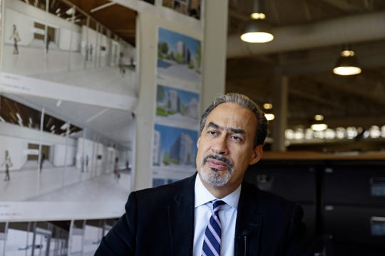 In this Jan. 18, 2017, photo, architect Phil Freelon responds to a question during an interview at his office in Durham, N.C. Freelon, the architect of the National Museum of African American History and Culture and other libraries, museums and schools, died Tuesday, July 9, 2019. Freelon was 66 years old and had suffered from ALS for several years.