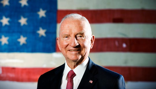 "Former Presidential candidate Ross Perot stands in front of a historic USS Constitution ""Old Ironsides"" American flag in his offices in Plano, Texas on Sept. 27, 2012. Perot died July 9."