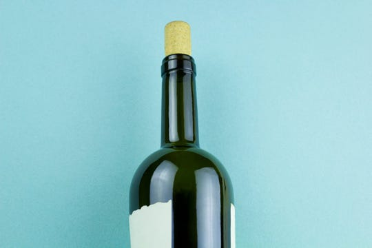 Photo of wine bottle on flat-lay