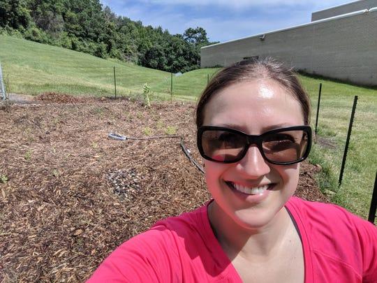 Minnesota science teacher Alli Driessen is maintaining a rain garden at her school.