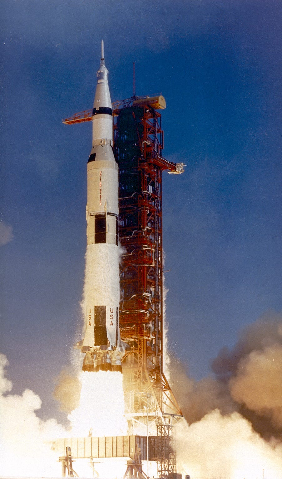 This photograph shows the Saturn V launch vehicle (SA-506) for the Apollo 11 mission liftoff at 8:32 am CDT, July 16, 1969, from launch complex 39A at the Kennedy Space Center. Apollo 11 was the first manned lunar landing mission with a crew of three astronauts: Mission commander Neil A. Armstrong, Command Module pilot Michael Collins, and Lunar Module pilot Edwin E. Aldrin, Jr. It placed the first humans on the surface of the moon and returned them back to Earth. Astronaut Armstrong became the first man on the lunar surface, and astronaut Aldrin became the second. Astronaut Collins piloted the Command Module in a parking orbit around the Moon.