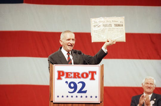 Independent presidential candidate Ross Perot holds aloft a copy of the 1948 Chicago Daily Tribune newspaper proclaiming Thomas Dewey the winner over Harry Truman in that year's presidential election.   Perot displayed the paper while addressing a rally Sunday, Nov. 1, 1992 in Long Beach, Calif.