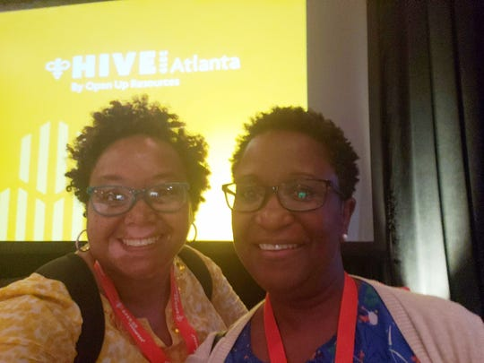 "Middle school math teachers Quinci Dacus, left, and Cynthia Phillips, right, spent the beginning of their summers at an Atlanta conference organized by a curriculum company. ""To be a good teacher you have to be always willing to learn more,"" Dacus said."