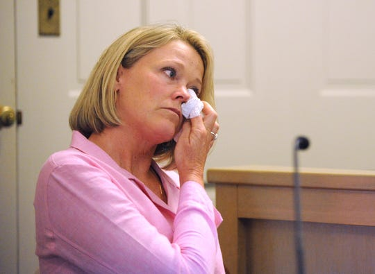 Heather Unruh, a dilapidated Boston TV news anchor and the accuser's mom, wipes away tears at the originate of her testimony in Nantucket District Court docket Monday, July 8, 2019.