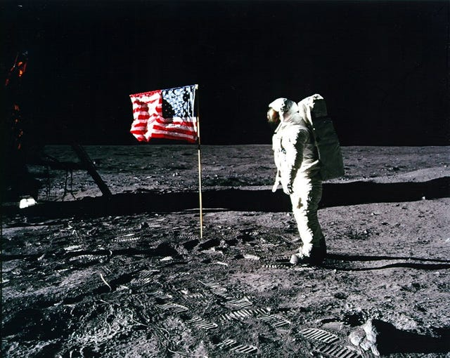 'Apollo 11' astronaut Edwin 'Buzz' Aldrin stands by the American flag planted on the surface of the moon on July 20, 1969. Apollo 11 landed Commander Neil Armstrong made this photo.