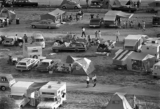 Thousands of spectators camped out on beaches and roads to watch the launch of Apollo 11, which launched at 9:32 a.m. Eastern on July 16, 1969.