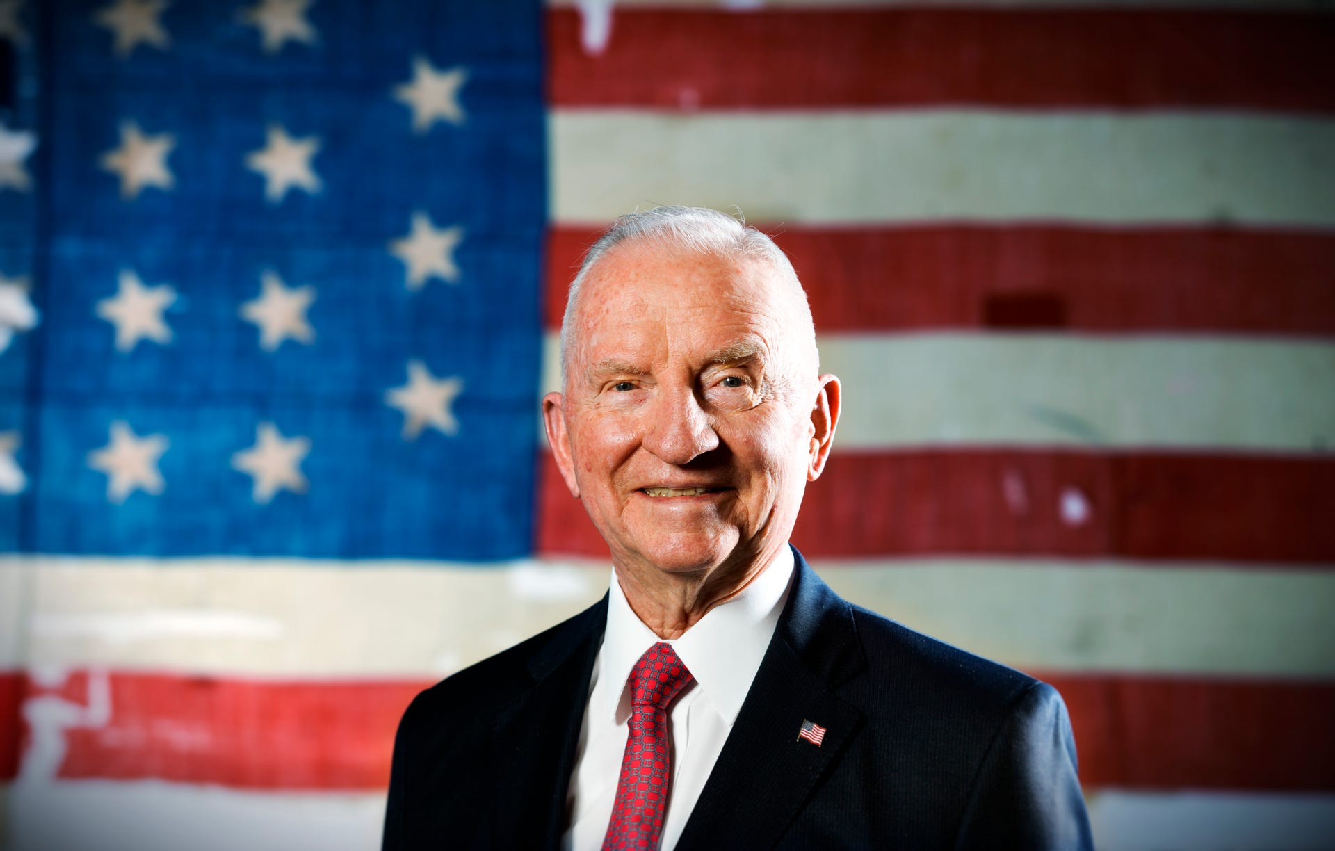 "Former Presidential candidate Ross Perot stands in front of an historic USS Constitution ""Old Ironsides"" American Flag in his offices in Plano, Texas on Sept. 27, 2012.  Perot, the Texas billionaire who twice ran for president, has died, a family spokesperson said Tuesday, July 9, 2019. He was 89."