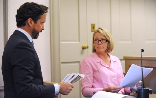 Kevin Spacey's attorney Alan Jackson, left, presents photos to witness Heather Unruh, the accuser's mother, in Nantucket District Court Monday, July 8, 2019.