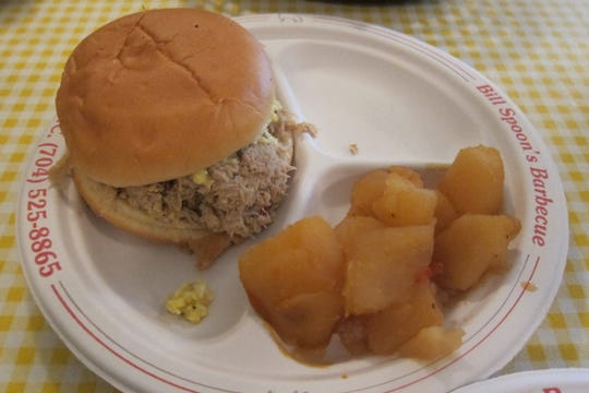 You can try Bill Spoon's whole-hog BBQ as a sandwich, which is piled with crunchy cole slaw.