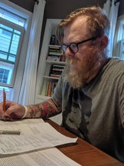 Wisconsin science teacher John Kish plans out his curriculum for next year.