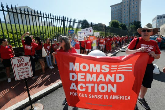 Moms Demanding Action line up during a rally for tighter gun laws at the State Capitol in Richmond in July.