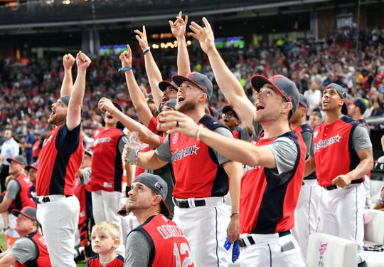 National League players react to the long home runs hit at the Derby.