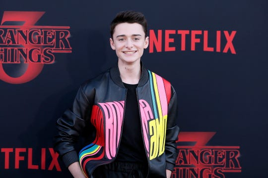 Noah Schnapp poses for photos on the red carpet prior to the premiere of 'Stranger Things: Season 3' in Santa Monica, California on June 28, 2019.