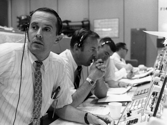 These are the flight controllers at Space Center in Houston, as the Apollo 11 mission's lunar landing module descends to the surface of the moon on July 20, 1969.
