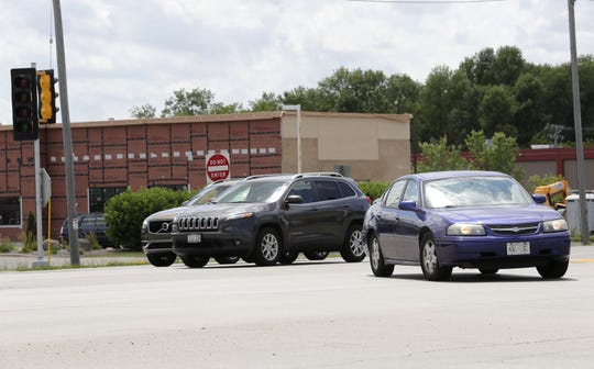 Traffic congestion at the intersection of  College Avenue and Kools Street in Grand Chute will be compounded by the opening of a Chick-fil-A restaurant visible in the background.