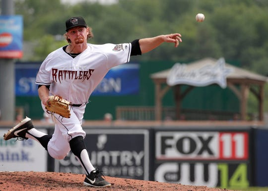 Scott Sunitsch delivers a pitch against the Beloit Snappers on July 8 at Neuroscience Group Field at Fox Cities Stadium in Grand Chute.