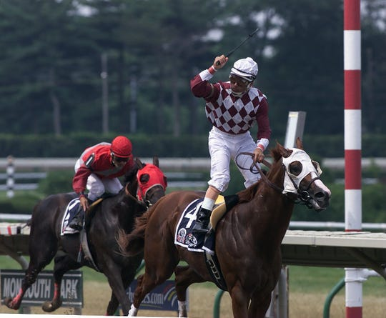 Jose Ferrer celebrates aboard City Zip after winning the 2001 Jersey Shore Breeder's Cup at Monmouth Park.